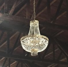 Elegant chandeliers in a raw location creates the perfect combination of intimate and cool