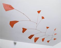 ALEXANDER CALDER (1898–1976)     Red Polygons, circa 1950		  	MEDIUM		Painted tin and wire mobile  DIMENSIONS	33 1/2 x 34 x 65 in.