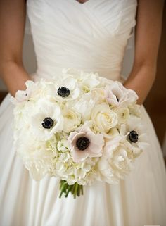 Bridesmaids bouquets, but add blush peonies and blue thistle