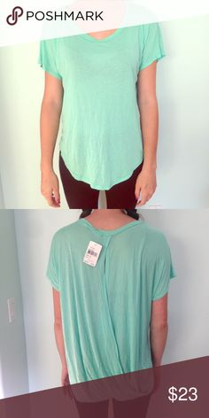 Mint blouse Flowy sea foam blouse. Soft and comfy material. Back overlaps, keyhole opening. Super cute and unique, tags still attached. Lush Tops Tunics