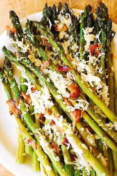 Asiago, Bacon, and Garlic Roasted Asparagus – a delicious way to cook asparagus! Asparagus comes out crispy and crunchy – you'll love the Asiago cheese and bacon combination! The recipe takes 30 minut Gluten Free Sides Dishes, Keto Side Dishes, Side Dish Recipes, Vegetable Recipes, Asparagus Recipes Oven, Oven Roasted Asparagus, Asparagus Bacon, Asparagus Appetizer, Asparagus Casserole
