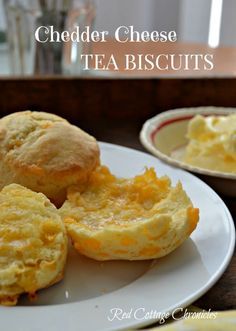 Cheddar Cheese Tea Biscuits warm from the oven, smothered in butter. Start to finish in about 20 minutes. Yummy memories from my childhood! redcottagechronicles.com