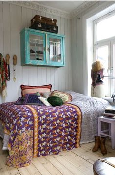 bohemian bedroom. i really like slated wooden walls, especially with grey like neutral tones and a couple of bright accent colours.