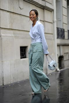 Aimee Song's silver sandals peeked out under her wide-leg pants.