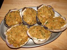 Rhode Island Stuffed Quahogs                              I make the best!  My mother's recipe of course! Her recipe is not attached to this pin, but this picture looks a lot like ours!