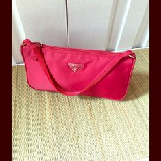 AUTHENTIC PRADA RED TESSUTO POCHETTE Authentic, RED, PRADA TESSUTO POCHETTE. This is a genuine PRADA item. No signs of wear, in immaculate condition inside and out. Gift this to a deserving young lady. Price is firm, no bundling this item, no trades. My Environment is clean, organized, pet/smoke free. Please make any inquires, all sales are final on PM. Thank you for shopping my closet. Prada Bags