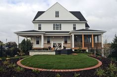 Matt Shimon and Mike Cuthbert built a farmhouse inspired new home in a Lakeville development - Spirit Of Brandtjen Farm. This is a view of the side yard.