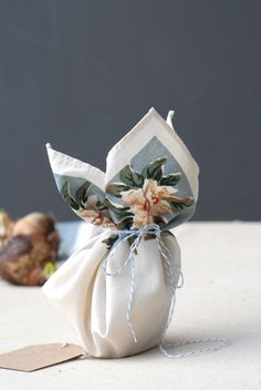 paperwhites (or any bulb flower) wrapped in a vintage handkerchief