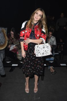 Drew Barrymore attends Coach 75th Anniversary: Women's Pre-Fall and Men's Fall Show on December 8, 2016 in New York City.