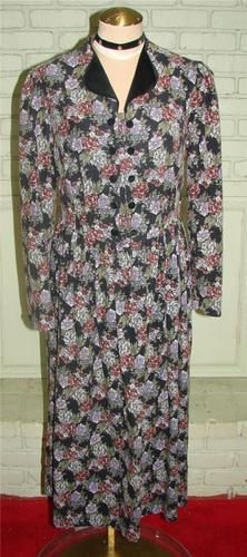 """Laura Ashley UK black and purple flowered tea dress. Black velvet collar with buttons to the waist. Long sleeves that close with fabric buttons. Natural waist with a full skirt,side zipper .In excellent condition.  Cotton corduroy. $40.00 Measurements Bust                36"""" Waist              30"""" Hips                48"""" Length             49"""" Tag                 10"""