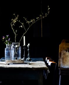 A moody black room with lighter-hued accents