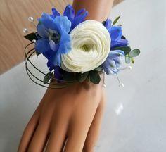 Blue prom wrist corsage . white ranunculas and blue delphinium