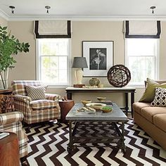 Layer Patterns and Bold Prints | Layers of classic patterns and bold prints connected by a warm palette of brown, ivory, and green give this D.C. cottage a hefty dose of handsome hospitality. | SouthernLiving.com