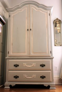 Nice Shabby Chic armoire in a  nice color. Would look cool in my girls room