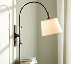 These are amazing and so functional.  They move up/down, side to side and the lamp shades are adjustable, too.  Perfect for reading in bed.