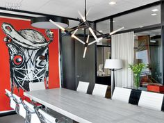 Meyer Davis Studio puts a residential spin on this NY office space where Red Man by Aaron Curry appears in the conference room alongside a chandelier by Lindsey Adelman and chairs by Charles and Ray Eames. Photography by Eric Laignel. Interior Design Magazine, Office Interior Design, Office Interiors, Room Interior, Interior Colors, Commercial Design, Commercial Interiors, Commercial Lighting, New York Office