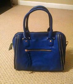 My Urban Expressions Elisha Zipper Accent Structured Satchel. This is a lot bigger than I normally do, but I luv the color and the zippers and realize this size is the trend. Again, probably the style push I needed. I'll give it a whirl!