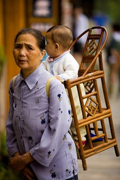 Actually mobility for toddler. Traditional Chinese Chair-carrier