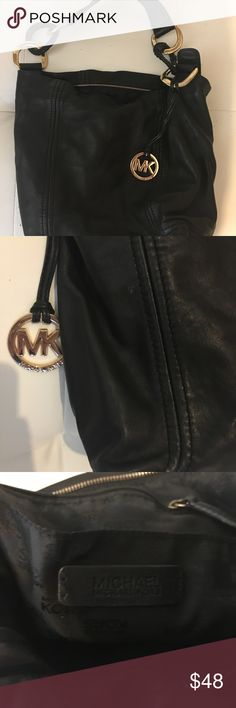 Black Michael Kors Purse Used Black MK shoulder bag. Still in good condition , a couple scratches on Gold from being used, inside of Purse is like new. Michael Kors Bags Shoulder Bags