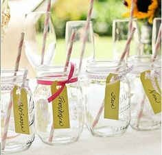 Cute, simple idea for a birthday party or wedding shower. Mason jar with tag name.