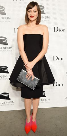 Marion Cotillard made a striking appearance at the Guggenheim International Gala Pre-Party in a black wool-and-silk bustier Dior Haute Couture dress, adding interest with a metallic Dior clutch and fuchsia-red ombre Dior Haute Couture booties.