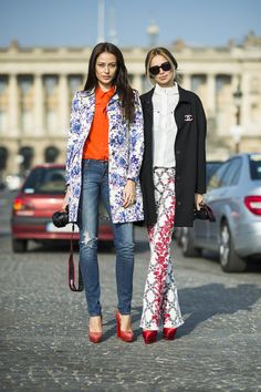 Très Chic! The Best Street Style at Paris Fashion Week: These showgoers kept coordinated in pretty florals and red heels.  Source: Le 21ème | Adam Katz Sinding