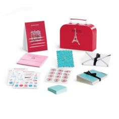 Bon Voyage Stationery Set for Girls,  A red paperboard suitcase with an Eiffel Tower graphic & a metal clasp and handle to hold it all 10 notecards with 5 different designs, each with foil trim     10 envelopes with a heart pattern and foil trim     2 sheets of icon stickers, and 1 sheet of foil and red heart stickers to seal the envelopes     A mini notepad with a heart icon     10 tear-out postcards in 5 different designs in a special booklet     A stationery pad with lined tear-out...Z