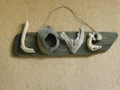 Driftwood love word, Valentine gift. $65.00, via Etsy.