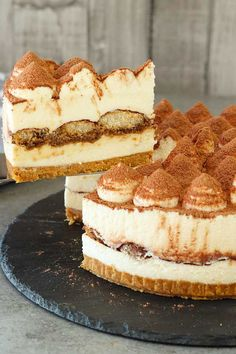 No-Bake Tiramisu Cheesecake - El Mundo Eats - - Another version of the world famous tiramisu dessert, this is a no-bake tiramisu cheesecake. Incorporating the essential flavours of a tiramisu, this no-bake cheesecake is easy to prepare. Tiramisu Dessert, Tiramisu Cheesecake, Baked Cheesecake Recipe, Tiramisu Brownies, Cheesecake Desserts, No Bake Tiramisu Recipe, Classic Cheesecake, Homemade Cheesecake, No Bake Desserts