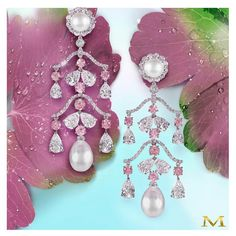 Pink diamonds and pearls... complete heaven! Gorgeous natural pearl and white diamond chandelier earrings accentuated with beautiful round pink diamonds. #moussaieffjewellers