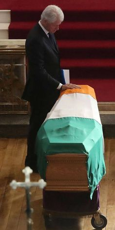 Sometimes a picture tells a story as President Clinton pays respect to Martin McGuinness