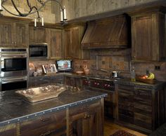 like these cabinets and the dark grey granite w rough edge, vent hood is cool too