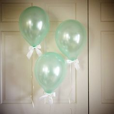 These mint balloons with white bows are perfect for a 21st birthday celebration!