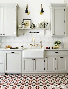 Cabinet color, brass hardware, cement tile in a kitchen
