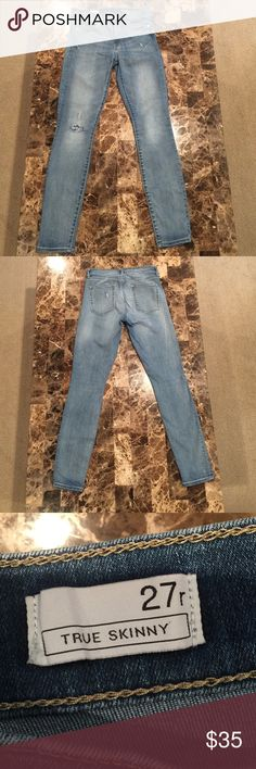 """Gap True Skinny Destructed Jean sz 27/4 Light Wash Fit & Sizing Fit: Skinny through the hip and thigh. Cut: Mid rise. Leg opening: Skinny. Inseam: 29""""/74 cm regular Gap size 27.  87% Cotton, 12% Polyester, 1% Spandex. Machine wash.  product details Made to flatter. Premium denim with medium stretch. Medium indigo wash. Zip fly, button closure. Five-pocket styling. GAP Jeans Skinny"""
