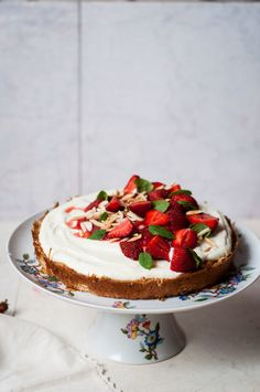 gluten-free oat, almond and coconut sponge cake with honey yogurt, rhubarb-strawberry compote and fresh strawberries