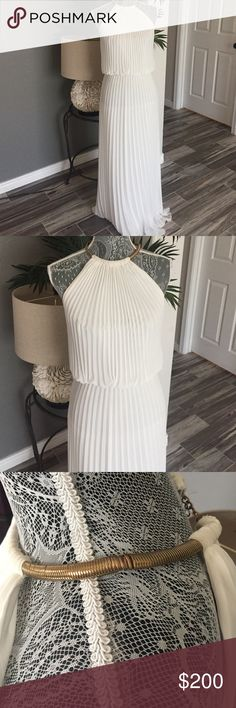 xscape by joanna chen dress Metallic-trimmed halter style with a trumpet silhouette Halterneck with back lobster clasp closure Sleeveless White the neck chain was a tad stretch please see pics. The dress will have to be cleaned due to wear. Has make up near neck around Xscape Dresses