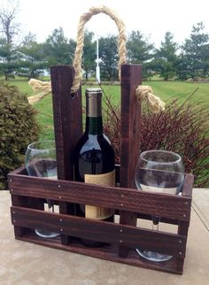 This rustic wine carrier is handmade from reclaimed wood pallets and slats. All carriers can be customized with a variety of stains. Please message