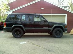 """Black Dog"", 1998 Jeep Cherokee (XJ) sporting plasti-coted Canyon wheels."