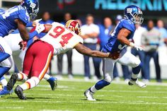 Shane Vereen of the New York Giants runs past Preston Smith of the Washington Redskins at MetLife Stadium on Sept. 25, 2016 in East Rutherford, N.J.