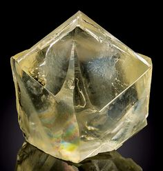 Super gemmy twinned crystal of golden Calcite with an internal rainbow