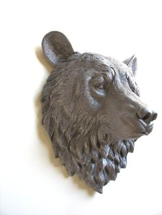 Large faux bear head adds a majestic fun and coziness into any home or kids room! Made out of resin. Painted in MEDIUM GRAY. HOW DO I HANG HIM? You can hang him up with a very strong nail or plastic screw anchor or a dry wall screw anchor. All what you basically need is a hammer and nail. Please use common sense when hanging him and where you are hanging him. All animal head have a hole in the back for easy hang up. He has felt dots on the back, so as not to scratch your wall…