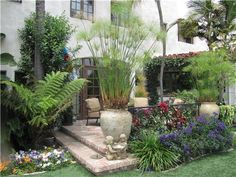 This patio feels like its own outdoor room thanks to the lush plantings on all sides. Get more ideas for your patio makeover here: http://www.landscapingnetwork.com/patios/new-patio-design-tips.html
