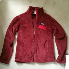 Patagonia Re-tool zipper fleece Women's size XS Fleece in excellent condition.  Color is a burgundy red. Patagonia Jackets & Coats