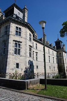 Aspremont-Lynden Castle (Dutch: Kasteel d'Aspremont-Lynden) is a castle in Oud-Rekem in the commune of Lanaken, province of Limburg, Belgium.  The present castle, on the site of a mediaeval predecessor, was constructed by the noble family of d'Aspremont Lynden, Counts of Rekem, in the early 17th century, in the style of the Maasland Renaissance.  The building served during the 19th and 20th centuries as a prison and a psychiatric hospital.