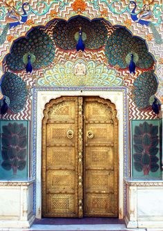 India door entrance archway with peacock, gold, gilt