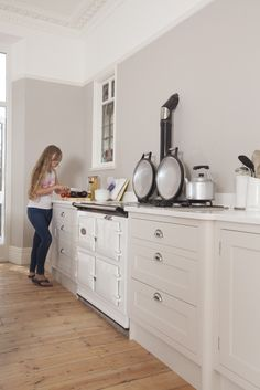 Skimming Stone from Farrow and Ball matches the gorgeous pale Aga in this Shaker kitchen from www.chalkhouseinteriors.co.uk