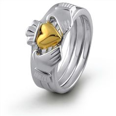A modern take on the classic -- a Claddagh stacking ring.  (I like the two-tone, too)