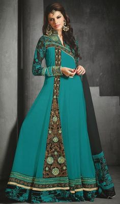 Be the dainty beauty in your onlookers eyes donning this greenish blue georgette long Anarkali churidar dress. The incredible dress creates a dramatic canvas with superb lace and resham work. #LongEveningWearDress