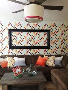The Herringbone Shuffle Stencil on a family room feature wall | Knock It Off! television show | LiveWell Network